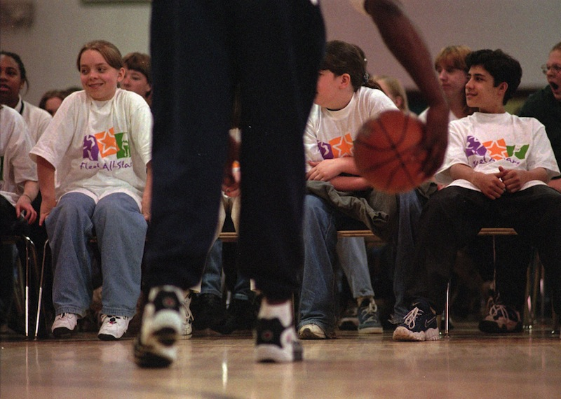 In this 1997 file photo, Lincoln Middle School students participate in a basketball skills demonstration. After budget cuts, the Portland school district's middle school athletic directors and coaches are stepping up to save their schools' seventh-grade field hockey as well as girls' and boys' basketball and soccer teams. (AP Photo / Carl D. Walsh)