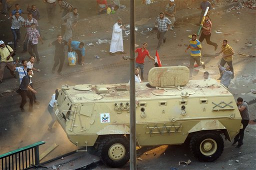 Supporters of ousted Islamist President Mohammed Morsi capture an Egyptian security forces vehicle at the Ministry of Finance in Cairo on Wednesday.