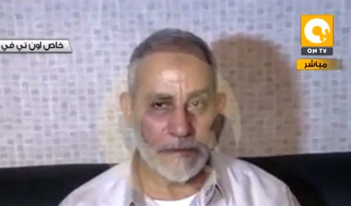 In this image taken from Egypt State TV, Mohammed Badie, the supreme leader of the Muslim Brotherhood, is seen after being detained by Egyptian security in Cairo on Tuesday. Badie had been in hiding near the huge sit-in in support of the country's ousted Islamist president, which security forces violently dispersed a week ago, leaving hundreds dead.