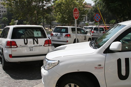 A U.N. team that is scheduled to investigate an alleged chemical attack that killed hundreds last week in a Damascus suburb leaves their hotel in a convoy in Damascus on Monday.