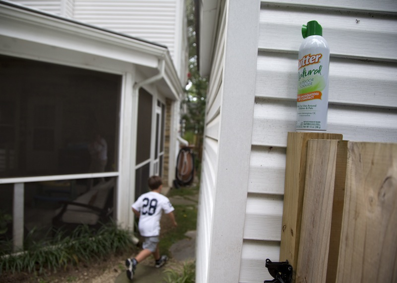 Ryan Miller's son Seaton Miller, 4, runs between homes in Arlington, Va., Monday, Aug. 19, 2013, past a can of bug spray. Miller has been lobbying his local government to break out the pesticides this year to fight mosquitos. Despite our size and technological advantages, we still can't seem to win our ancient blood battle with the pesky and lethal mosquito.. A large section of the United States seems like it is getting eaten alive worse than usual this summer because of quirks in recent weather. It may be the worst in the Southeast, where after two years of drought when mosquito eggs laid dormant, there have been incredibly heavy rains much of the spring and summer. The rains have revived the dormant eggs, so the region is essentially getting three years' worth of mosquitoes in one summer. (AP Photo/Carolyn Kaster)