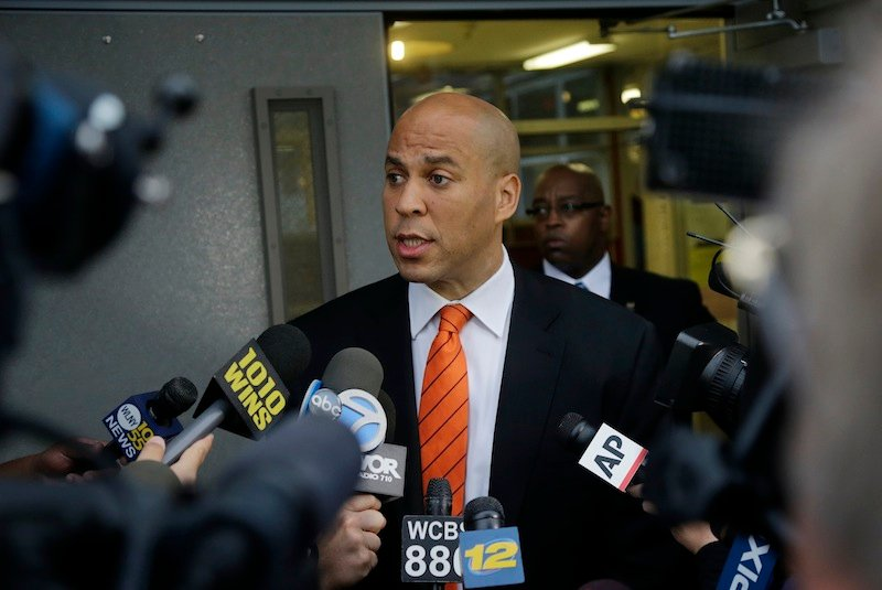 Newark Mayor and Senate candidate Cory Booker answers a question after he voted in a primary election Tuesday, Aug. 13, 2013, in Newark, N.J. Low turnout was expected Tuesday as New Jersey voters decide which candidates will run to fill the seat of the late U.S. Sen. Frank Lautenberg, who died in June. Democrat Booker and Republican Steve Lonegan are expected to easily win their party primaries. Barring an upset, the two will square off in an Oct. 16 special election, with the winner headed to Washington for the remaining 15 months of Lautenberg's term. (AP Photo/Mel Evans) Cory Booker