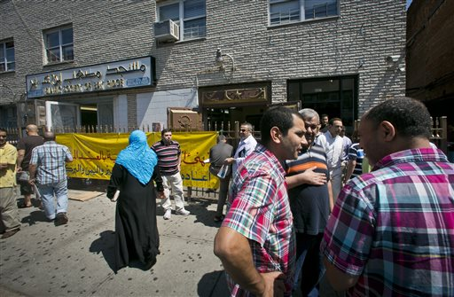 Visitors socialize outside the Islamic Society of Bay Ridge and mosque, after a Jumu'ah prayer service on Aug. 16, 2013, in the Brooklyn borough of New York. The New York Police Department targeted the mosque as a part of a terrorism enterprise investigation beginning in 2003, spying on it for years. The mosque has never been charged as part of a terrorism conspiracy.