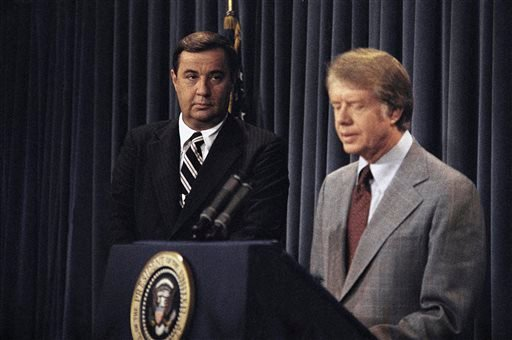 In this Aug. 18, 1977, photo, President Jimmy Carter tells reporters that his confidence in Bert Lance, left, were reconfirmed by a report of federal investigators that found nothing warranting prosecution in his Georgian banking activities.