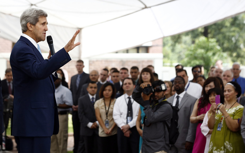 U.S. Secretary of State John Kerry, left, speaks to staff members at the U.S. Embassy in Islamabad, Pakistan, on Thursday. The U.S. closed down 21 embassies and consulates across the Muslim world for the weekend because of a high threat level.