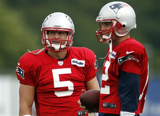 New England Patriots football quarterbacks Tim Tebow, left, and Tom Brady chat during team practice in Foxborough, Mass., on Monday.