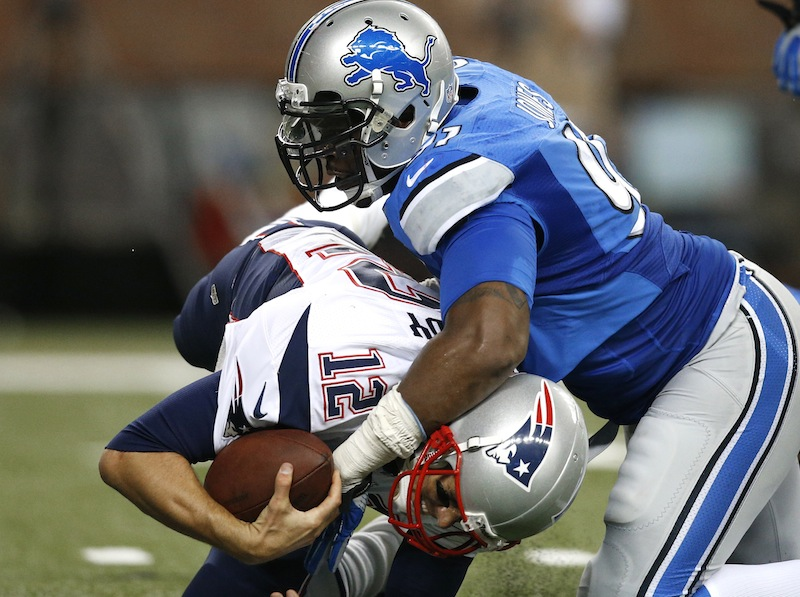 Lions defensive end Jason Jones sacks Patriots quarterback Tom Brady during the second quarter of Thursday's preseason game in Detroit, won in convincing fashion by the home team.