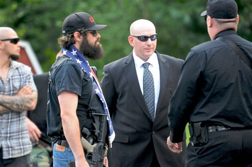 Gilberton Police Chief Mark Kessler, center, talks with members of the Constitutional Security Force before a Gilberton Borough Council meeting in this July 31, 2013, photo.