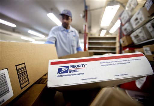 Packages wait to be sorted as U.S. Postal Service letter carrier Michael McDonald gathers mail to load into his truck before making his delivery run in Atlanta.