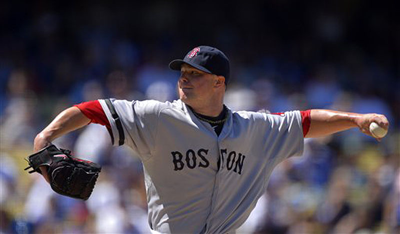 Red Sox starting pitcher Jon Lester throws to the plate in the fourth inning against the Los Angeles Dodgers on Saturday in Los Angeles.
