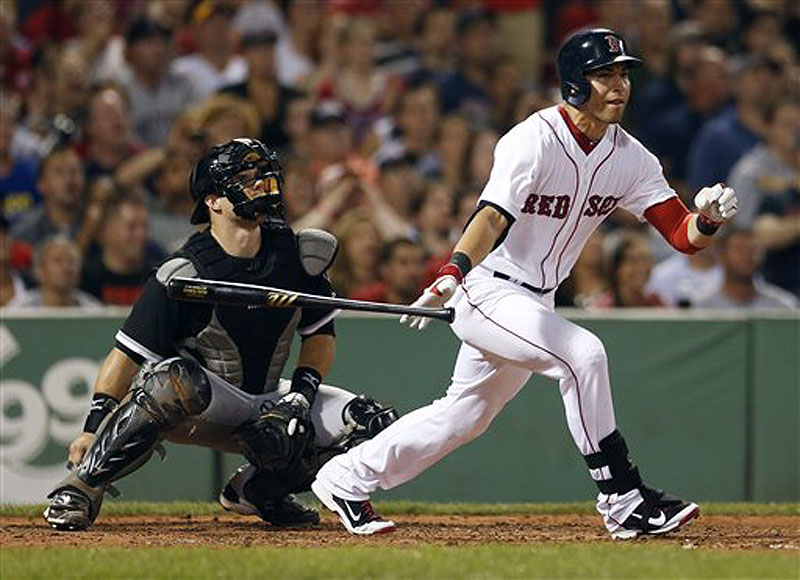 Jacoby Ellsbury follows through on a ground-rule double in front of Chicago catcher Josh Phegley in the fourth inning at Fenway on Saturday.