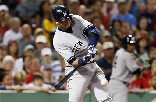 New York Yankees' Alex Rodriguez hits a single in the seventh inning of a game against the Boston Red Sox Sunday in Boston.