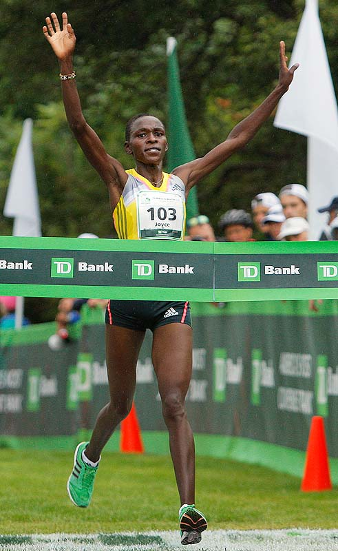 Joyce Chepkirui of Kenya crosses the finish line of the TD Beach to Beacon 10K Road Race on Saturday as the first female finisher with a time of 31 minutes, 23 seconds.