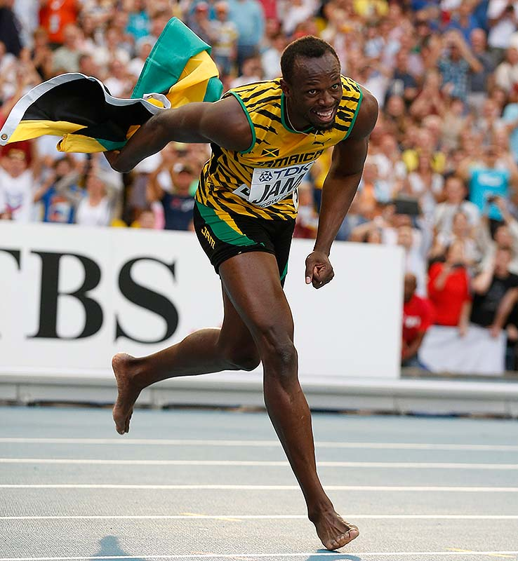 Jamaica's Usain Bolt dances after winning his third gold medal, in the men's 4x100-meter relay, at the world championships Sunday at Moscow.
