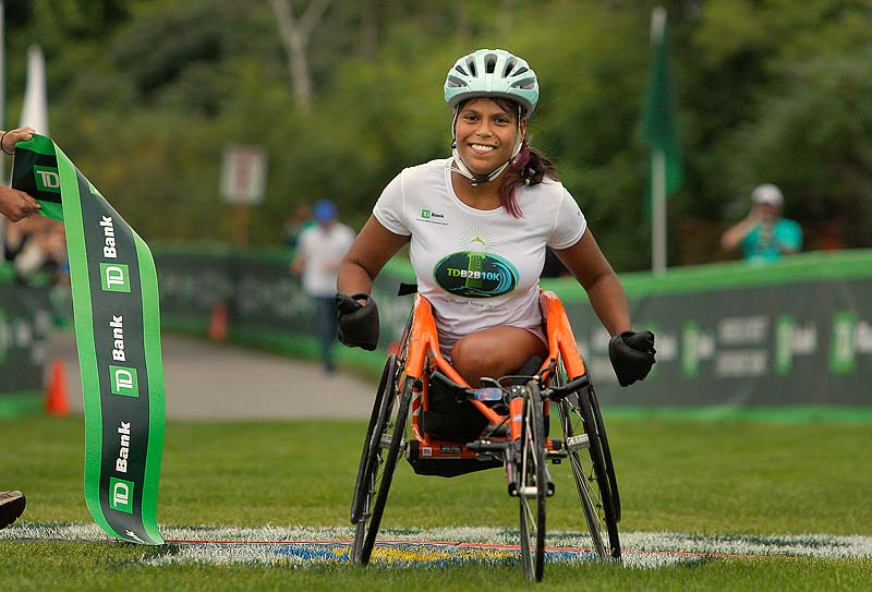 """Christina Kouros might have been the only woman in the wheelchair division, but she posted her best time on her hometown course. """"My town knows I do my best,"""" she said."""