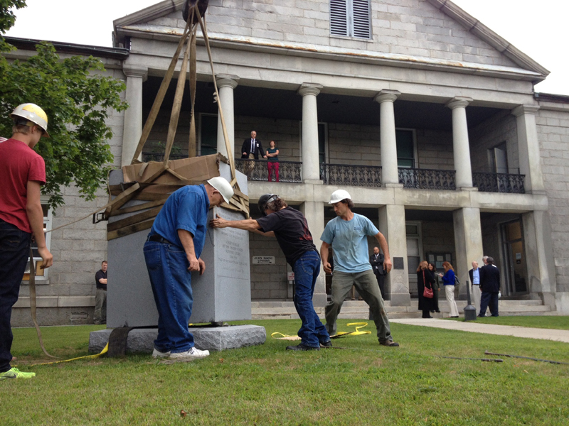 Crews from Masciadri Monuments and W.H. Green set a memorial for U.S. Chief Justice Melville Weston Fuller this morning in front of the Kennebec County Superior Court in Augusta. The Augusta native presided over the top court of the land from 1888-1910.
