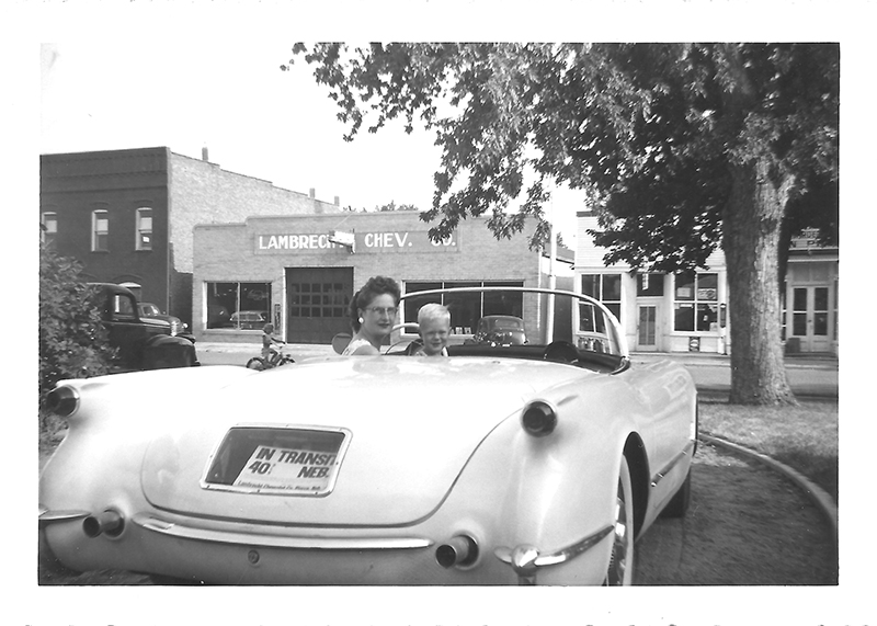 This family photo which was provided by Jeannie Stillwell, daughter of Ray Lambrecht of the Lambrecht Chevrolet car company in Pierce, Neb., shows Mildred Lambrecht, wife of Ray, and their son Mark in a brand new 1953 Corvette, in front of the dealership.