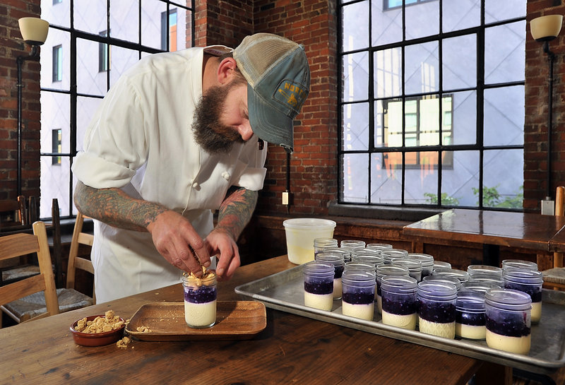 "Fore Street pastry chef Brant Dadaleares assembles a serving of his blueberry ""crisp,"" which features vanilla panna cotta, blueberry compote, almond crisp topping and a scoop of sweet corn ice cream."