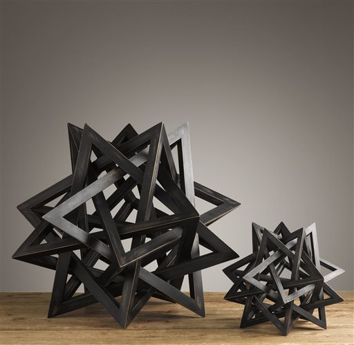 Geometric-shaped bowls are interspersed with conical and star-shaped maquettes, which are scale models used by architects in their study of form, structure and proportion.