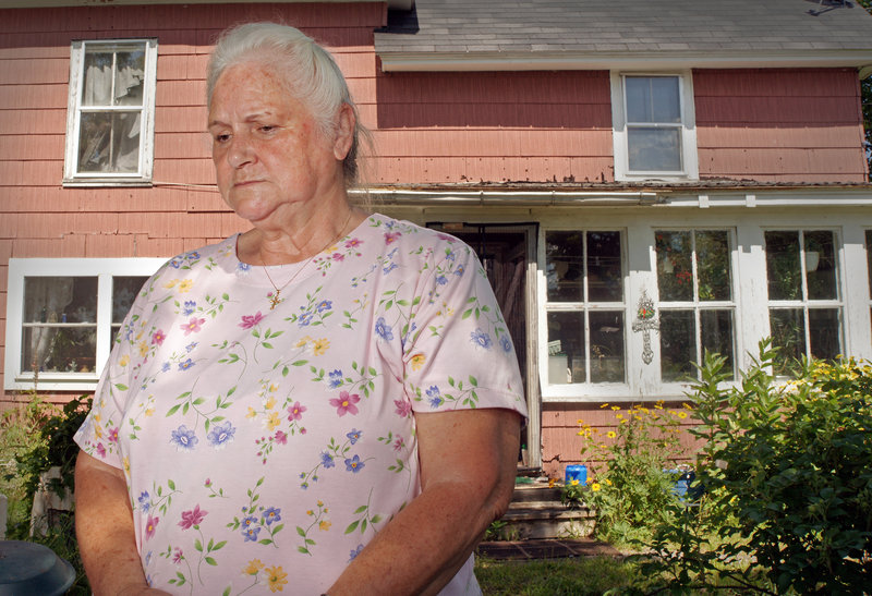Glenna Dean talks about the July 6 rail disaster in Lac-Megantic, Quebec, while standing in her Brownville yard last week. The wife of the pastor at the United Methodist Church, she worries about the fate of her rail-dependent town, where dozens of workers have been laid off.