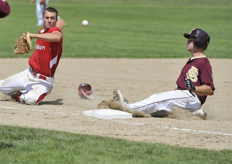 Drew Gelinas of Fayette-Staples of Saco slides into third base Thursday as shortstop Chandler Shostak of Red Barn of Augusta stops an errant throw from going into left field. Red Barn scored five runs in the ninth inning to remain alive and eliminate Fayette-Staples with an 11-10 victory.