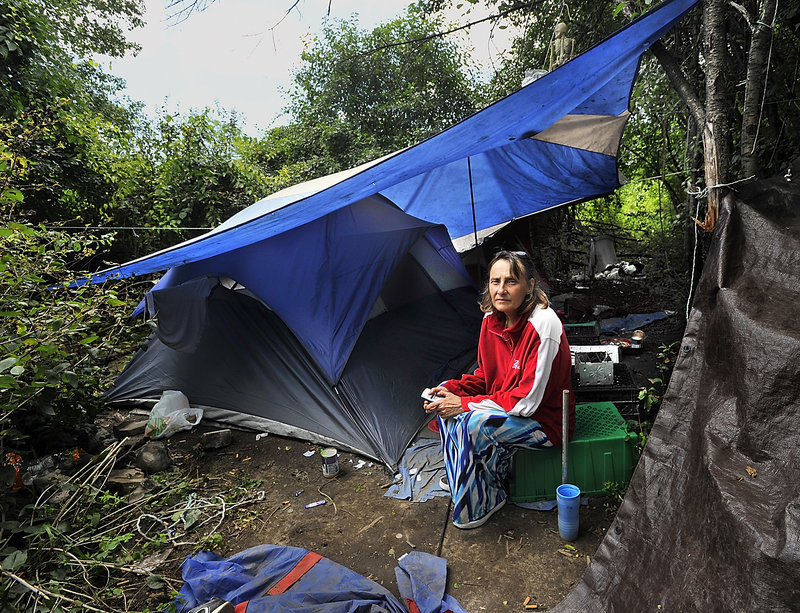 Anne Blake sits in the camp that's been her home for the past week after she and her partner were forced out of their Westbrook apartment.