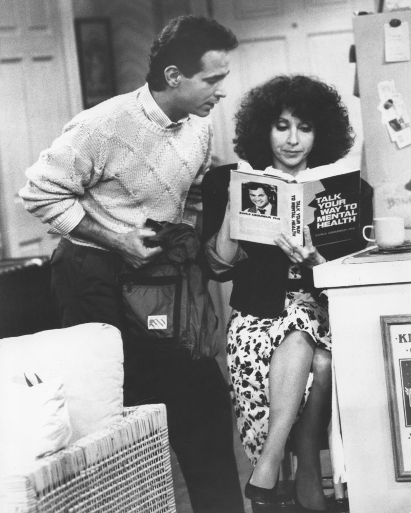 """Roxie, played by 1965 Deering High School graduate Andrea Martin, studies up on group therapy with her TV show husband, Mitchell Laurance, during a 1987 episode of """"Roxie"""" on the CBS Television Network."""