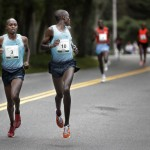 Silas Kipruto glances over his shoulder Saturday as he and the eventual race winner, Micah Kogo, set the pace early in the Beach to Beacon 10K in Cape Elizabeth.