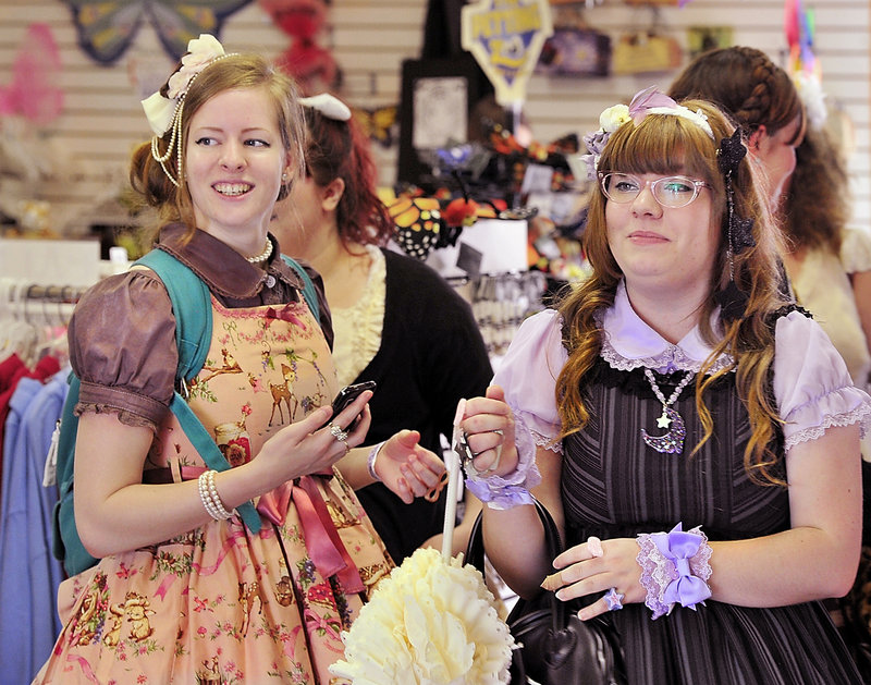 Maine Lolitas Rebecca Cole of Gray and Alesha Leach of Kennebunkport are all dolled up in their outfits at a gift shop at York's Wild Kingdom on Saturday.