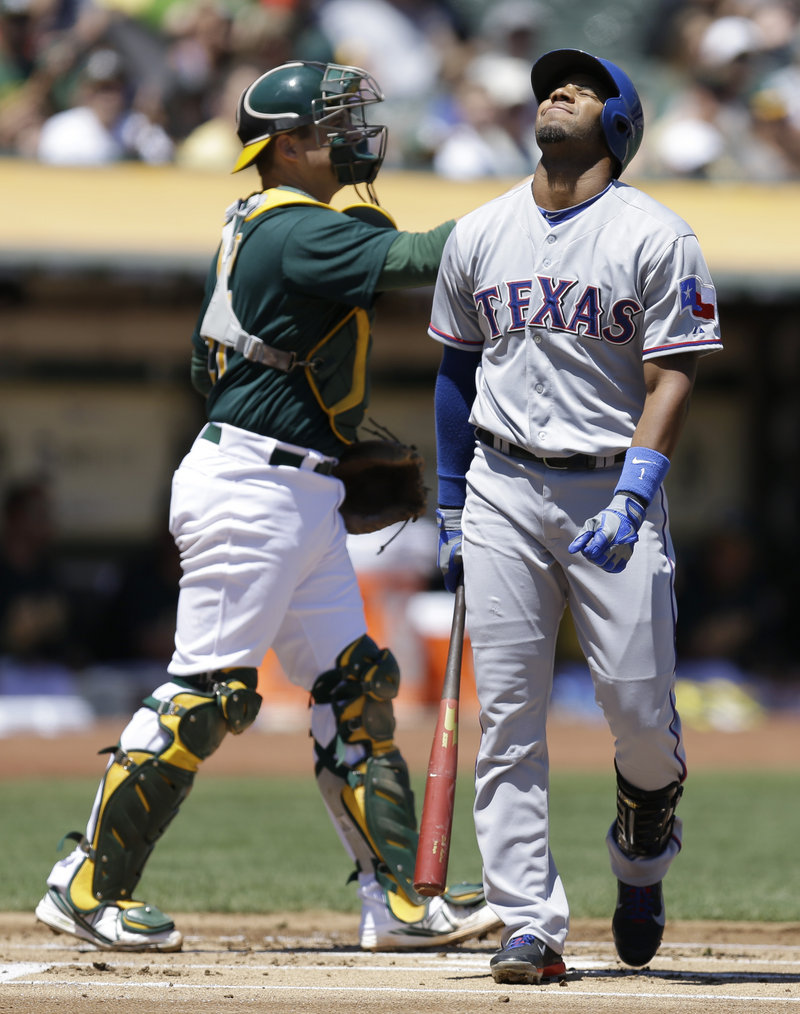 Elvis Andrus of Texas grimaces after striking out against Jarrod Parker in the first inning of a 4-2 win by the Athletics at Oakland, Calif., on Saturday.