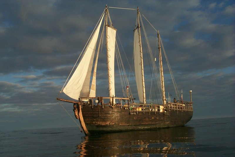 A still provided by documentary filmmaker Gregory Roscoe shows the galleon Raw Faith underway on a calm sea.