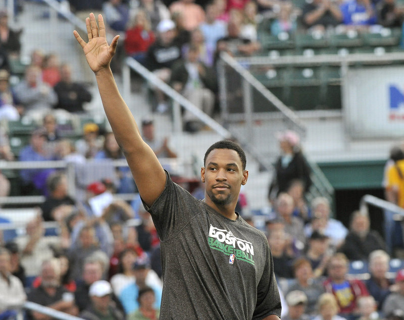 Jared Sullinger of the Boston Celtics arrived too late to throw out the first pitch but acknowledged the crowd during the game.
