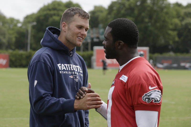 Tom Brady and Michael Vick exchange pleasantries during a joint Patriots-Eagles workout in Philadelphia prior to Friday's exhibition game.