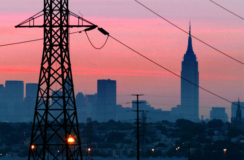 The Empire State Building towers over a darkened New York City skyline just before dawn on Aug. 15, 2003, the day after a tree branch in Ohio touched a power line and set off outages affecting 50 million people. Utilities and analysts say that changes made in the aftermath make a similar outage unlikely today, but that the U.S. electrical grid faces new stresses.