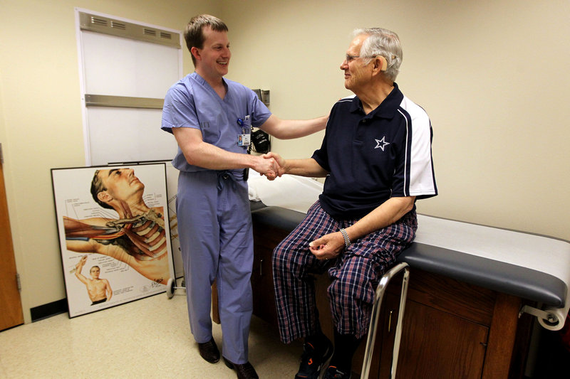 Dr. Mark Pool and patient Carl Smith are all smiles following successful bypass surgery at Texas Health Presbyterian Hospital Dallas – an delicate operation preceded and followed by prayer.