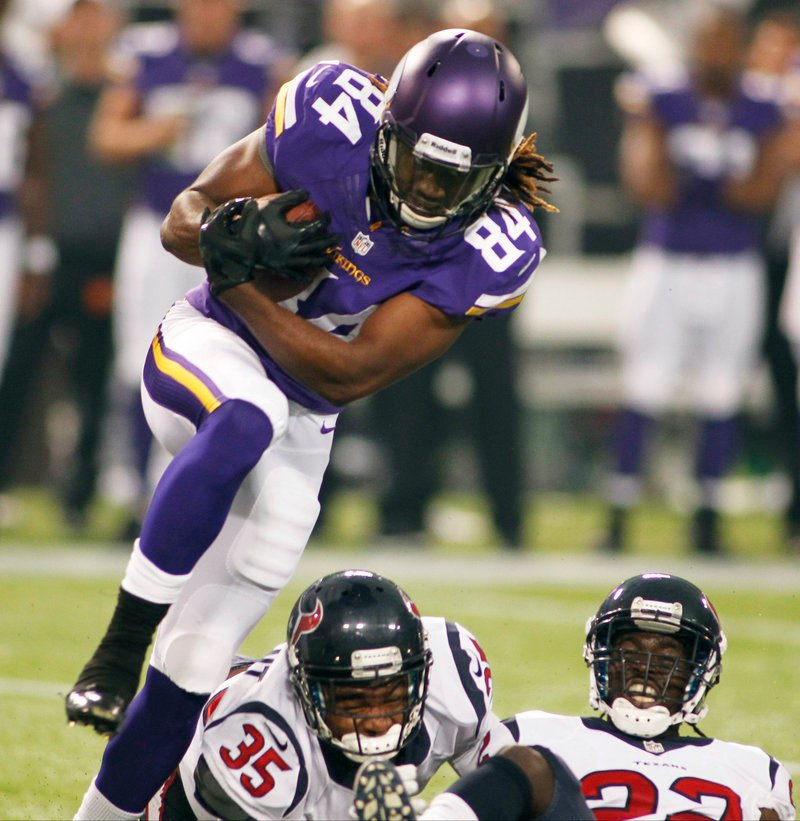 Cordarrelle Patterson leaps over two Houston defenders for good yardage during Minnesota's 27-13 loss in the preseason opener for both teams Friday night.