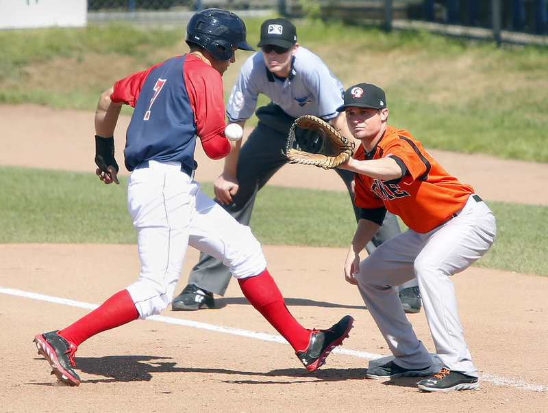 Garin Cecchini of the Portland Sea Dogs makes it back to first base as Buck Britton of the Bowie Baysox takes the pickoff throw during Bowie's 6-5 victory Sunday at Hadlock Field.