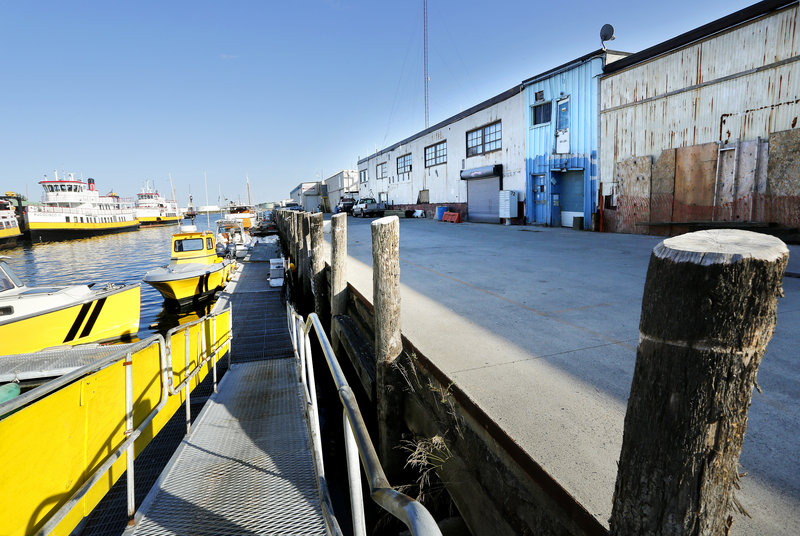 A view of the Maine Wharf in Portland, looking south towards the harbor. Photographed on Monday, August 12, 2013.