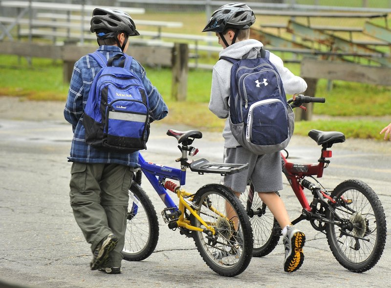 Wearing a helmet, as these two students at Lyseth School in Portland are doing, is one way bike riders can ensure their safety, a reader says.