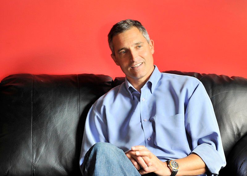 """Peter Carlisle talks about his career as a sports agent in his office at the MHG Ice Centre in Saco earlier this summer. He said when he started his own agency in 1997, he considered the growing popularity of action sports, such as snowboarding, and saw opportunity. """"He was a visionary,"""" says his brother, Jeff Carlisle."""