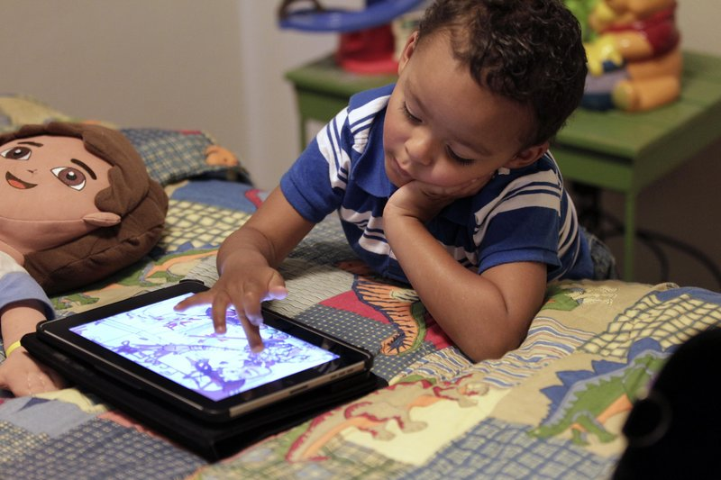 Playing with an iPad is more interactive than watching TV, and child development experts are divided over whether that makes mobile technology any better for young children.