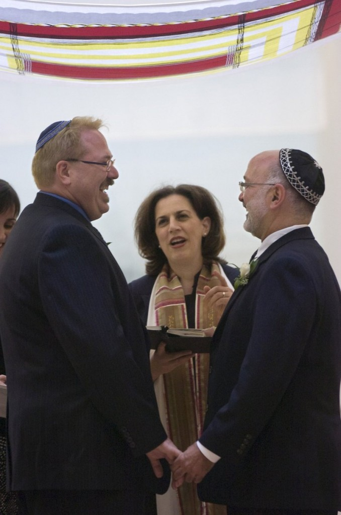 Rabbi Mona Alfi marries Dan Hoody, left, and Dave Felderstein at the Congregation B'nai Israel in Sacramento, Calif., during a brief window in 2008 when gay marriage was legal in the state – as it is once again.