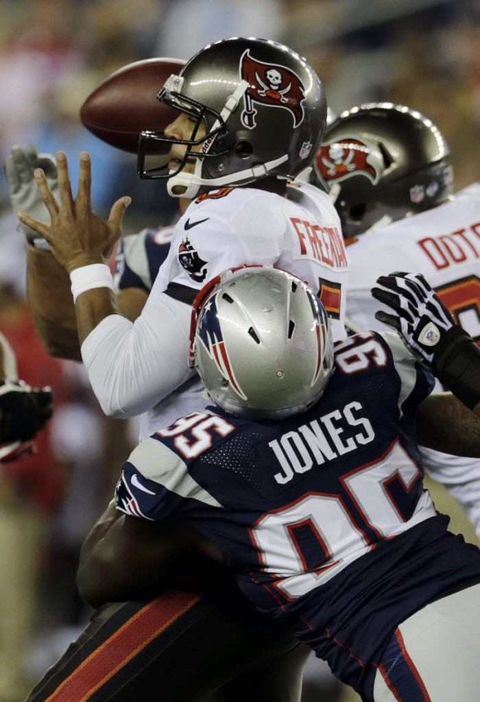 It's a rough night for Tampa Bay quarterback Josh Freeman, who was sacked three times, including this one by defensive end Chandler Jones.