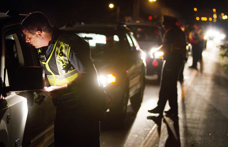 Brunswick Police Officer John Roma and other Cumberland County officers conduct sobriety checks Friday.