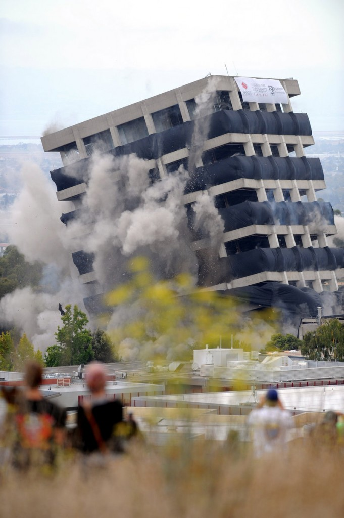 Declared seismically unsafe two years ago, Warren Hall is imploded in a data-gathering experiment on the campus of Cal State East Bay in Hayward, Calif., on Saturday.