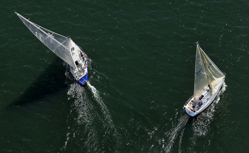 Two sailboats take different paths while competing in the MS Regatta in Casco Bay on Saturday.