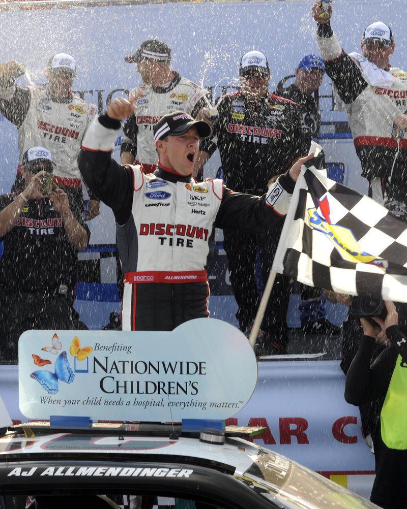 AJ Allmendinger celebrates his victory Saturday in the NASCAR Nationwide Series race at Mid-Ohio Sports Car Course in Lexington, Ohio.