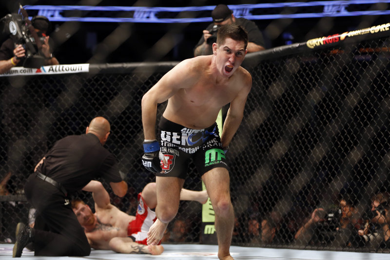 Steven Siler celebrates after knocking out Maine's Mike Brown in the first round during a UFC show Saturday night in Boston.