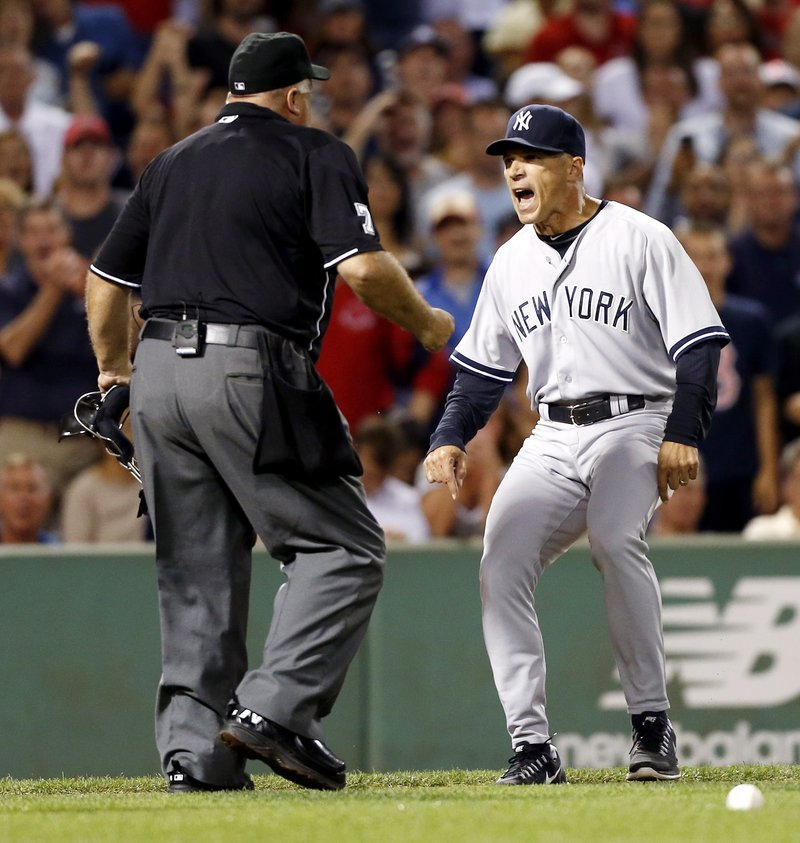 Yankees Manager Joe Girardi argues with home plate umpire Brian O'Nora after Boston's Ryan Dempster wasn't ejected for hitting Alex Rodriguez with a pitch in the second inning. Instead, Girardi was thrown out.