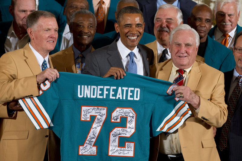 Former Dolphins quarterback Bob Griese, left, holds a signed jersey with President Barack Obama and former coach Don Shula during a White House ceremony Tuesday.